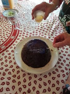 Christmas pudding with pouring Brandy on top